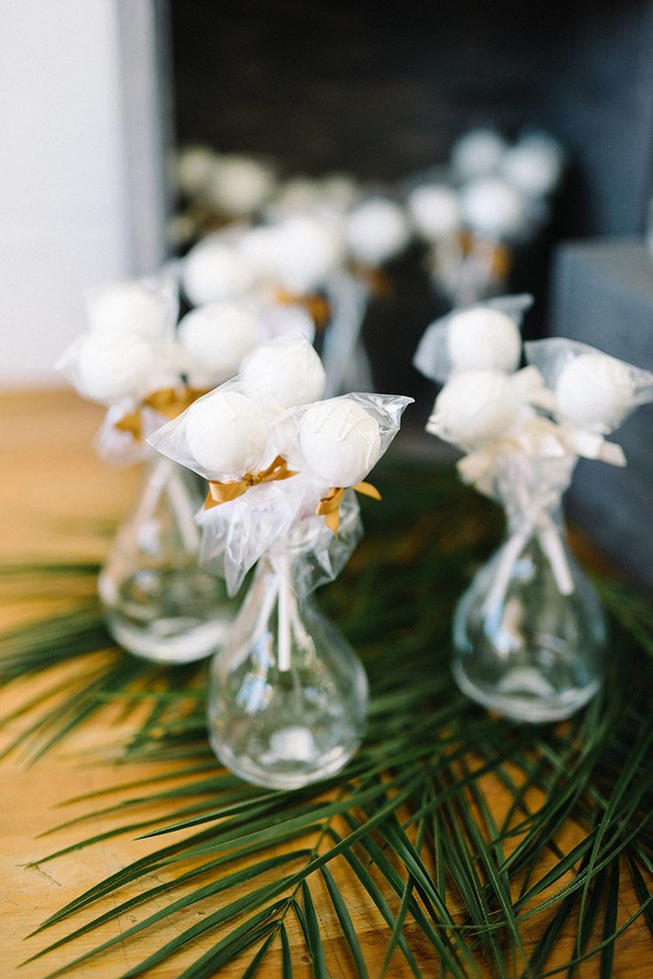 cake pop favors - photo by The Kama Photography http://ruffledblog.com/industrial-modern-wedding-with-a-greenery-wall