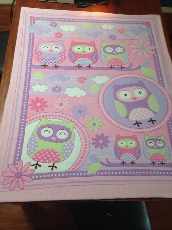 Machine quilted baby girl quilt. Handmade with 100% cotton batting.  www.facebook.com/druberryblankets