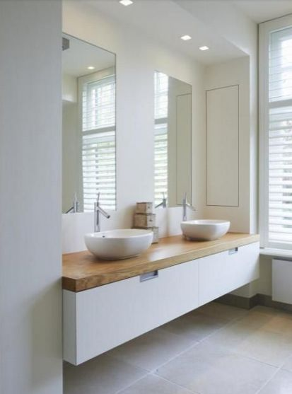 "Rosa Beltran Design: ""ORGANIC MODERN"" BATHROOM DESIGN. Thick wood counter with white floating vanity & vessel sinks."