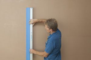 Roger Bisby Tries Out the Speedskim Plastering Tool