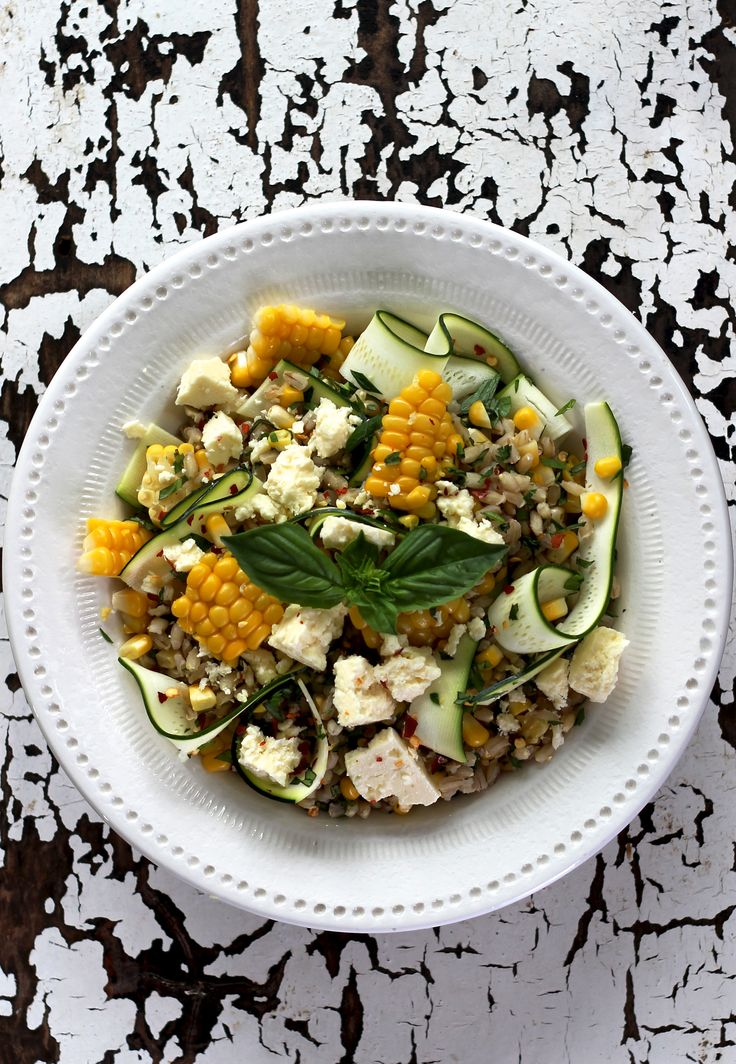 PEARL BARLEY, FETA, CORN & ZUCCHINI RIBBON SALAD. Inspired by the fresh flavours of summer, this salad is simple and flavourful with crunchy zucchini, savory feta, sweet corn kernels and zesty lemon.  Vegetarian. 35 Minutes. Only 460 Calories Per Serve.