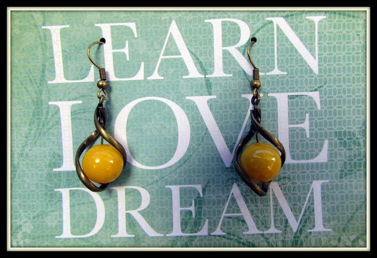 Sunshine Yellow Semi precious stone beads in a brass twist. www.madeit.com.au/MadeByKasame