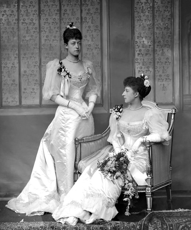 Bridesmaids Princess Victoria and Maud of Wales; sisters of Prince George, Duke of York [later George V] at his wedding to Princess May of Teck. Copyright V&A.