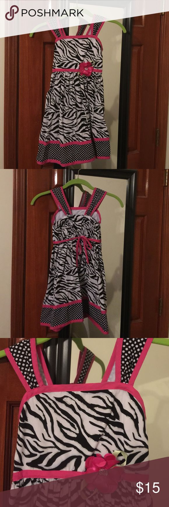 Very cute zebra print dress This is a zebra print dress worn just a couple times. It has silver sparkles outlining the zebra print. Pink sweater was purchased separately. Goes nicely with the dress for those cool sprin/summer days. Sweater is Sonoma brand size 5. Smoke free home! Youngland Dresses Casual