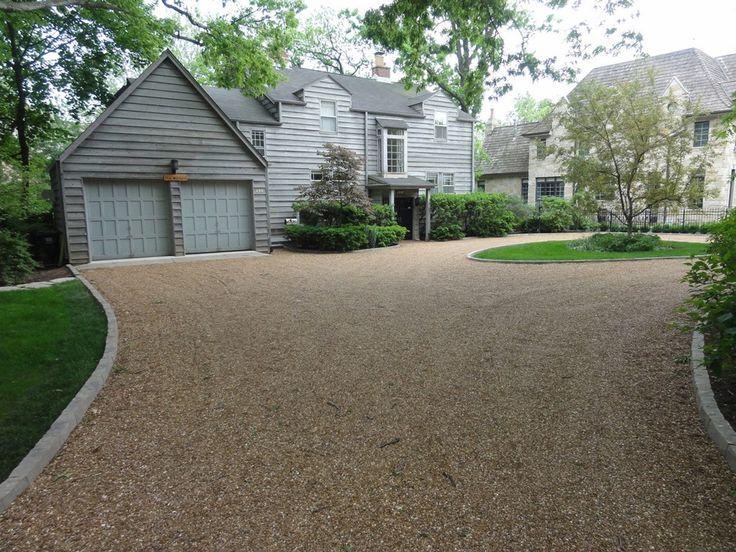 Pavers around gravel driveway