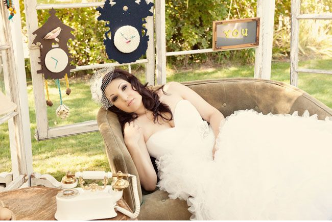 Jenn in outdoor room designed by InnCredible Events at Coloma Country Inn.  Clocks by Jenn, photography by Ashley Maxwell.