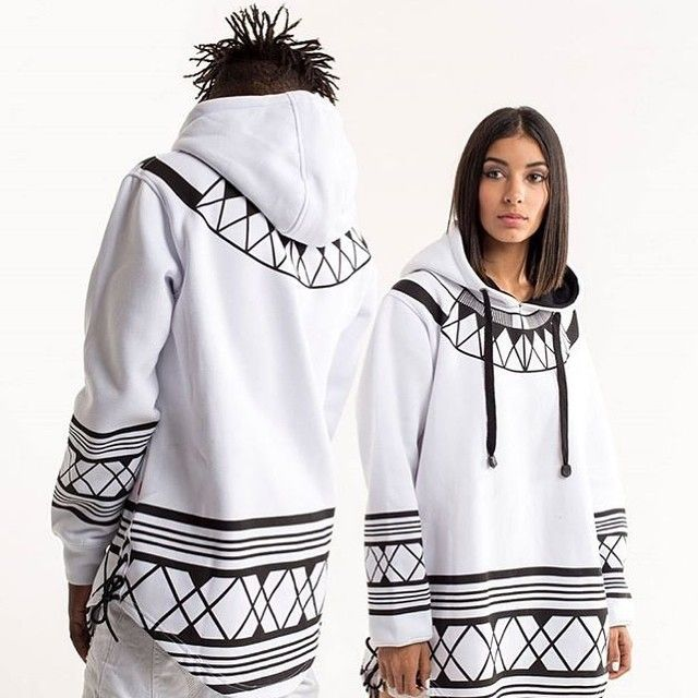 Clean lines inspired by Xhosa attire. This is the 'Wild Coast Dawn' extended hoodie by @butanwear [photo credit: @butanwear] #lovelocalprint