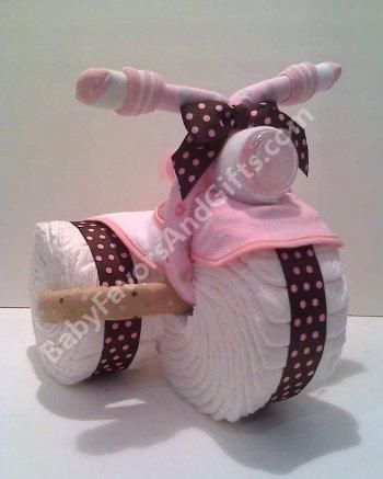 Tricycle diaper cake, Baby Shower gifts. A trully unique gift, contemporary & specially made for the new baby arrival. Greate gift for a new baby or beautiful centerpiece for Baby Shower. Best of all, the items can actually be used for baby!