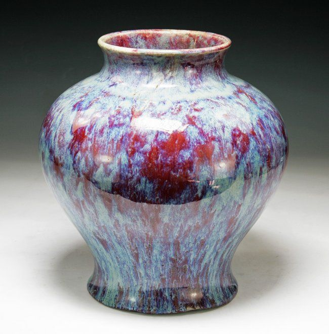 Big Chinese Qing Flambe Red Glazed Porcelain Vase: of shouldered globular body with short and wide neck, applied with deep purple glaze with blue splash, base glazed brown with foot left unglazed, of Late Qing Dynasty; Size: H: 10-3/4""