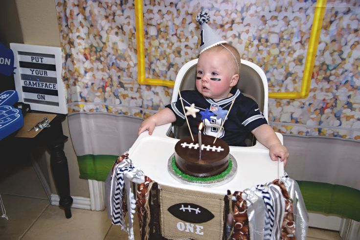 This 1st smash cake is about to go down. Fun football themed party down to the high chair. Go Grayson!