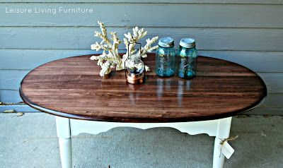 seen a lot of two-tone makeovers on oval tables. specifically wood top with matte color bottom