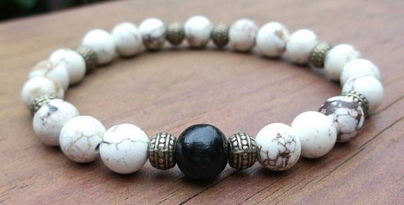 This gorgeous mens gemstone bracelet is made with 9mm Howlite stone beads, bronze beads and an Natural Ebony Wood bead.    Howlite Properties: