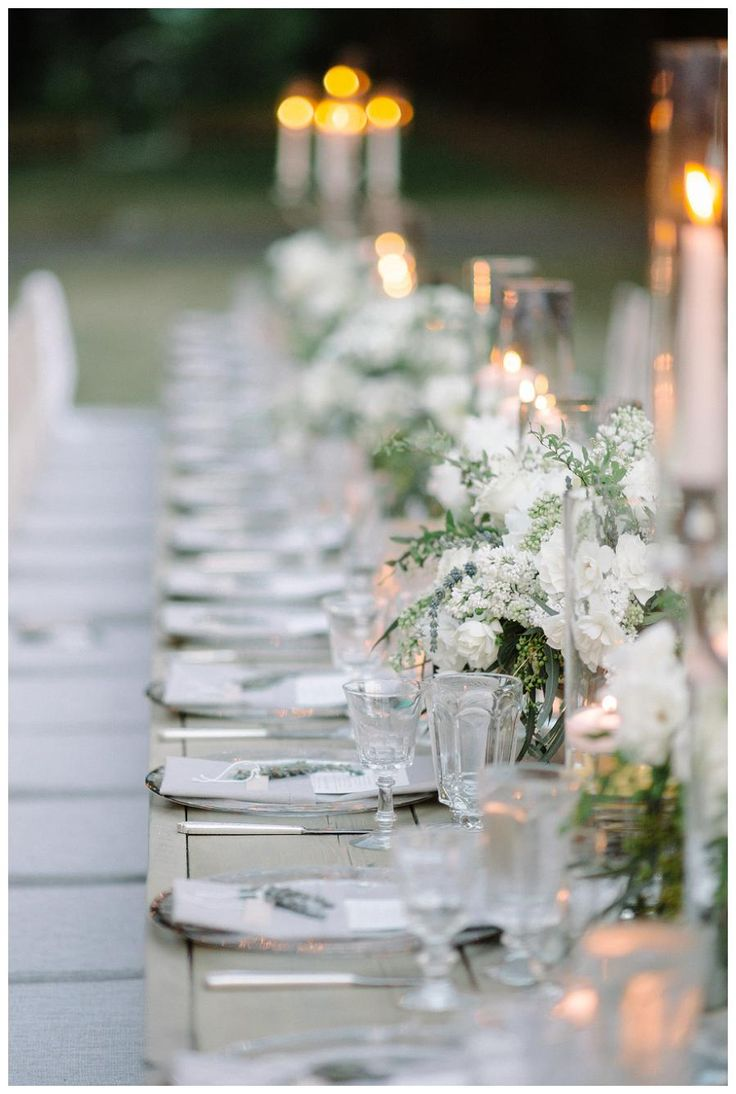 Wedding reception table with tall candelabras white for Glass tables for wedding reception
