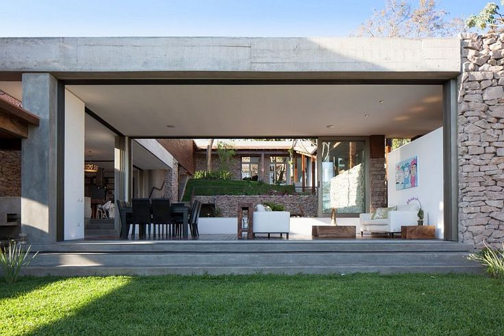 Ingenious open design of the living areas with glass doors connect them with the garden