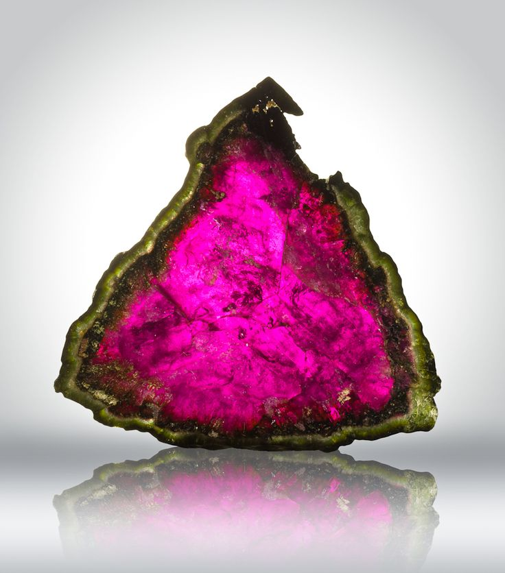"Watermelon tourmaline. Tourmaline is a crystal boron silicate mineral compounded with elements such as aluminium, iron, magnesium, sodium, lithium, or potassium. Tourmaline is classified as a semi-precious stone and the gemstone comes in a wide variety of colors. The name comes from the Sinhalese word ""Thuramali"" or ""Thoramalli"", derived from different gemstones found in Sri Lanka. [Wikipedia]"