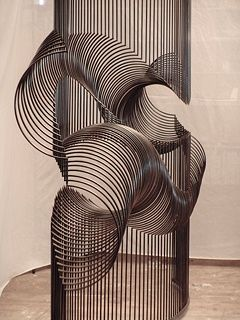 """McConnell Studios, """"Momentum."""" This piece is kinetic. Each piece individually sways, acting like a millipede in motion. With the added impact of the sound of metal, it is fully interactive."""