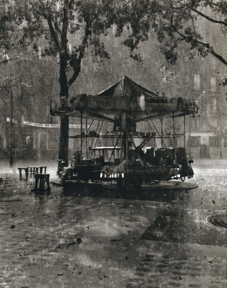 Black & White - The Poetry of Rain.  Robert Doisneau, M. Barre's Carousel, 1955.  Lots of other B rain photos.  http://thingsthatquickentheheart.blogspot.com/2011/08/black-white-poetry-of-rain.html