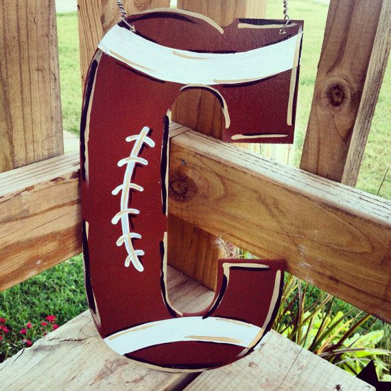 Hand-painted+football+themed+initial+door+hanger+by+allyinman