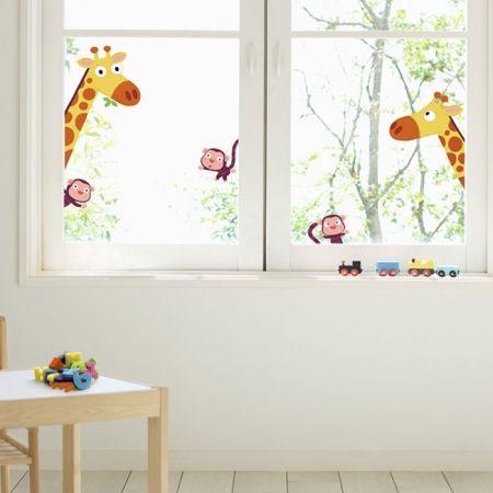 Giraffe & aap op het raam