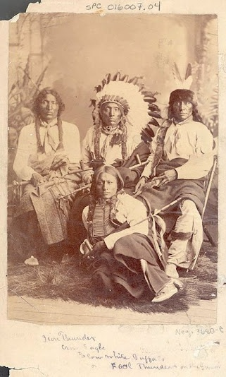 Sitting in back row L-R: Iron Thunder, Crow Eagle, Slow White Buffalo Sitting on floor: Fool Thunder - Hunkpapa - no date