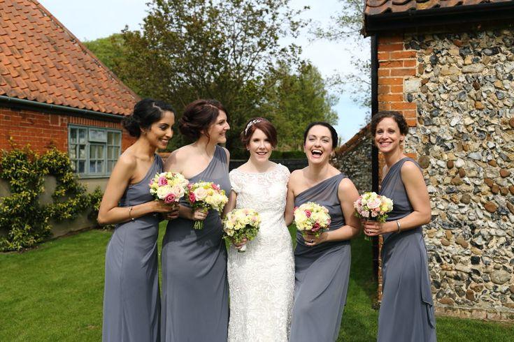fun group shot with bridesmaids, the granary barns suffolk