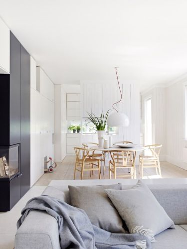 White kitchen, oak dining, soft grey sitting area, contemporary fireplace with black finish