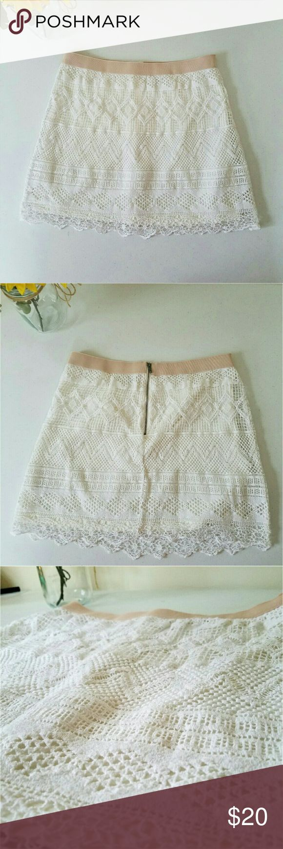 """Lace American Eagle Outfitters Skirt Gently worn. White lace with a cream lining and band around Waist. Material has stretch. No rips in lace. Zipper in back. Above the knee.   Measurements  Size 6 = small Length 16""""  Waist 27.5"""" Hip 37""""  Always willing to negotiate. American Eagle Outfitters Skirts"""