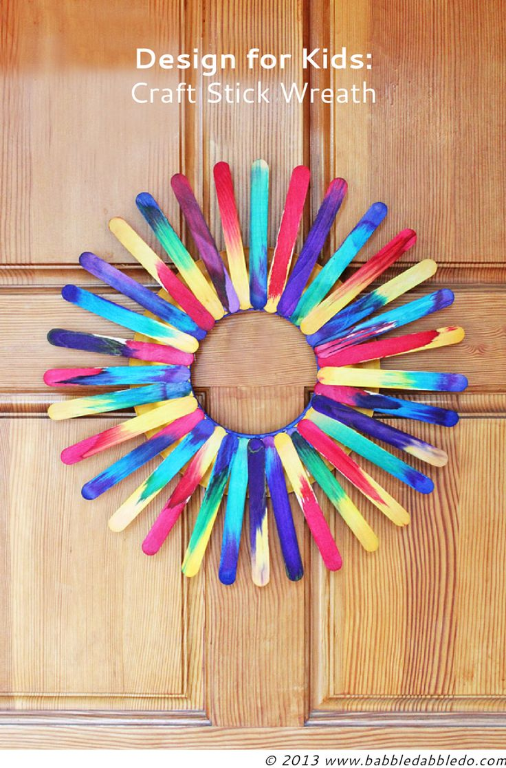 Craft Stick Wreath | BABBLE DABBLE DO All you need are crafts sticks, hot glue, and paper plates!