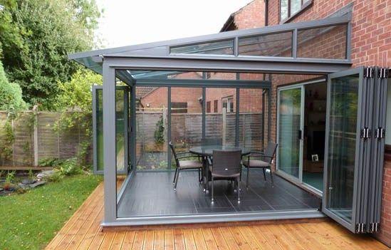 mini-grey aluminium conservatory with bi-folding doors