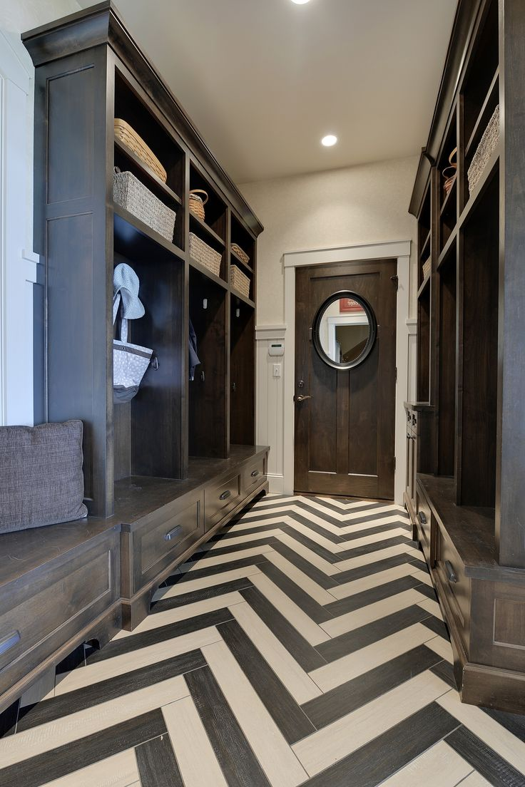 Love the dark cabinetry and herringbone floor!  #mudrooms homechanneltv.com