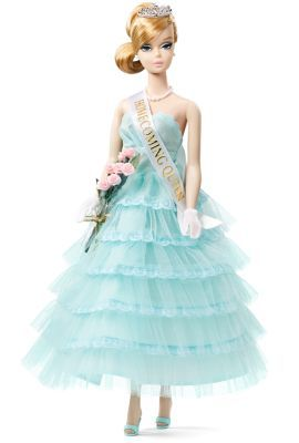 """2015: Homecoming Queen Barbie Doll. Strapless, aqua blue tulle and taffeta gown, matching peep–toe mules, and jewelry. Silvery tiara & a """"rose"""" bouquet. """"Vote Barbie"""" poster + dance tickets"""