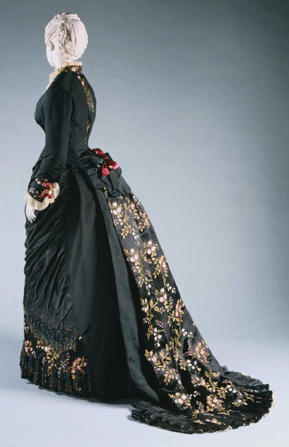 1878 Charles Frederick Work Day Dress.(Image via Philadelphia Museum of Art) Winter, black silk faille and brocaded floral silk.