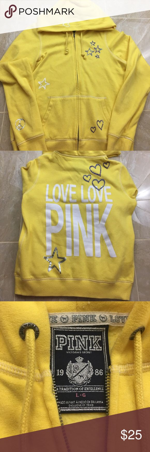 BARELY WORN PINK Victoria's Secret Hoodie A super soft fleece yellow zip-up hoodie from Victoria's Secret PINK. It has purple glittery details and small printed detailing as well. I have only worn it 3x so it is still in great condition with soft fleece in the inside. PINK Victoria's Secret Tops Sweatshirts & Hoodies