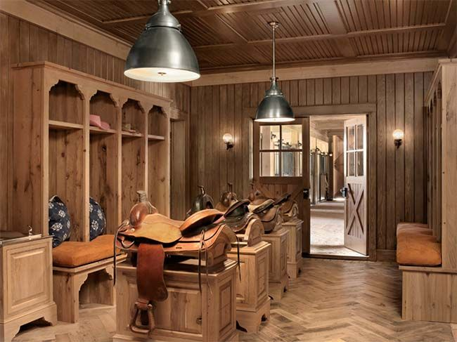 Tack room with mounted saddle racks plus more swoon worthy tack rooms.