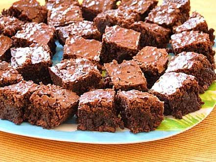 Ooey Gooey Brownies: all-purpose flour, baking powder, salt, salted butter, unsweetened cocoa powder, granulated white sugar, large eggs, vanilla extract, chocolate bars