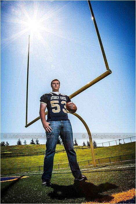 Awesome senior picture of this football player by his high school's field goal post. #seniors #football #sports