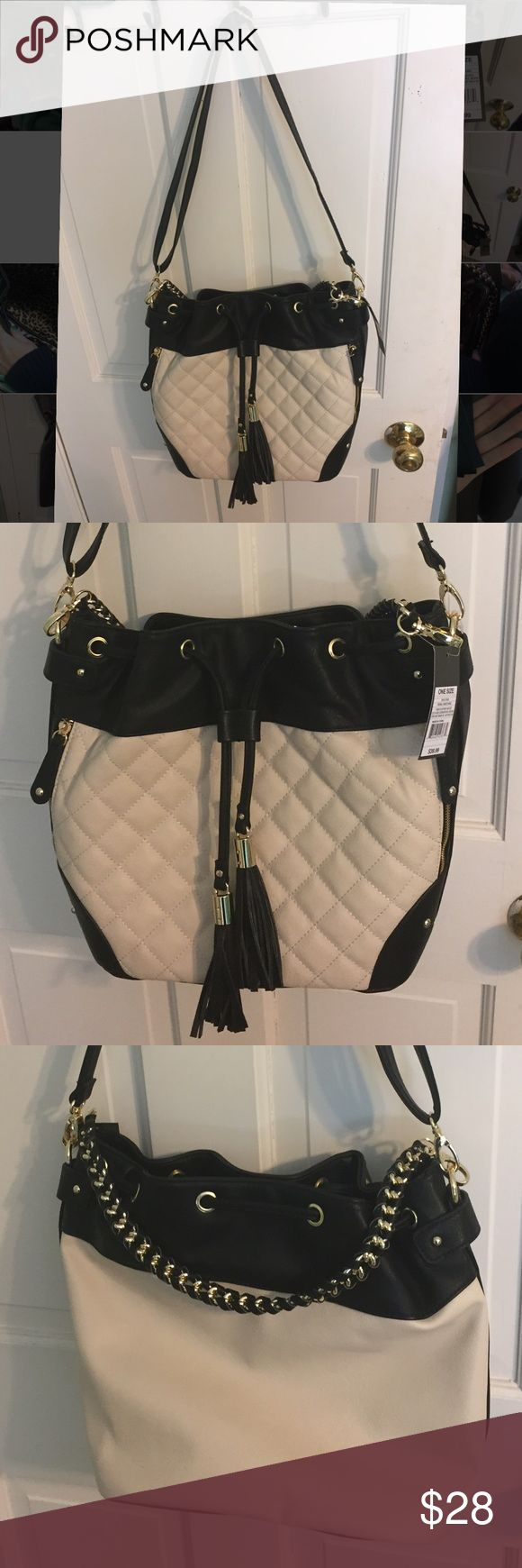 Adorable, NWT Target Purse Cream and black bag with detachable shirt braided strap and detachable long strap. Cheetah print interior with three pockets as pictures- very spacious. Tags still on. Detachable tassel that can hang in the front of a bag. No trades!! Mossimo Supply Co. Bags Crossbody Bags