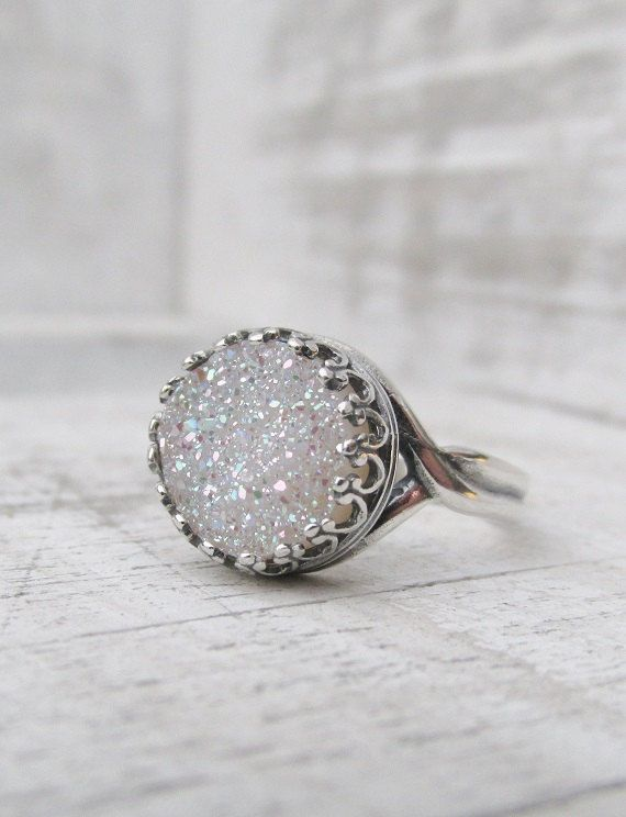 I want this Sooo bad - Evie This beautiful ring features a fabulous white druzy quartz with brilliant iridescence color. The stone measures 10mm with a Grade A fine