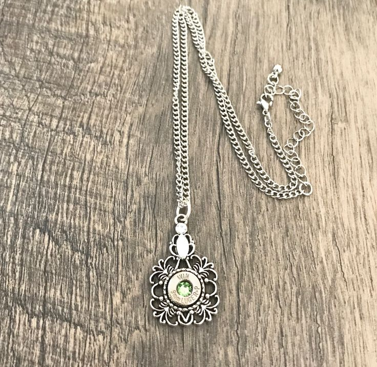 Bullet Shell Jewelry, Bullet Necklace, Peridot Necklace, Birthstone Jewelry, Birthstone Necklace, Ammo Jewelry, Bridesmaid Necklace, 9mm by MissyJeansBoutique on Etsy https://www.etsy.com/listing/566688275/bullet-shell-jewelry-bullet-necklace