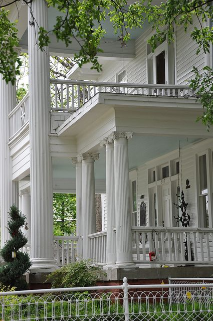 Large columns, sweeping front porches, and balconies are typical of a Southern home design. (Photo by vickiemarie)