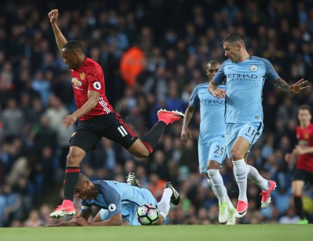 Anthony Martial of Manchester United in action with Vincent Kompany of Manchester City during the Premier League match between Manchester City and...