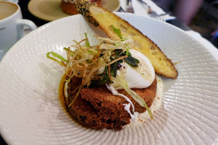 OTTOMAN EGGS $17 Poached free range eggs with crumbed eggplant, garlic labne, burnt chilli & sage served with a sourdough seeded baguette