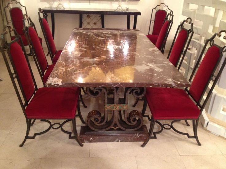 #Diningtable Art Deco, attributed  to #Poillerat, in green and gold patinated #wroughtIron, plateau and pedestals in red, brown and white #marble. Two original extension leaves can be added. With 8 matching chairs in wrought iron covered with red velvet. For sale on Proantic by Galerie Secula.