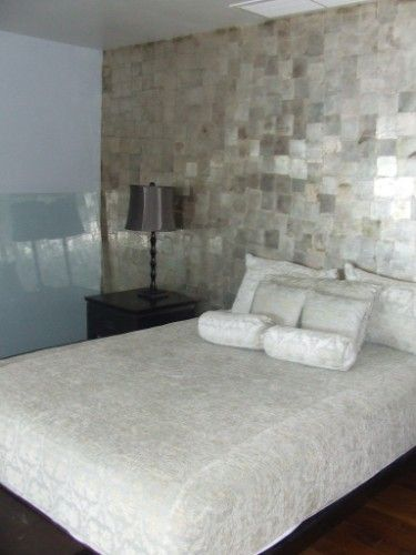 The feature wall in this room is reflective and textural