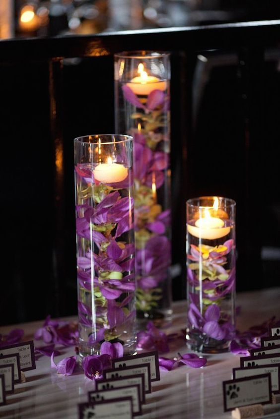 purple floating candle wedding escort card table / http://www.deerpearlflowers.com/floating-wedding-centerpieces/2/