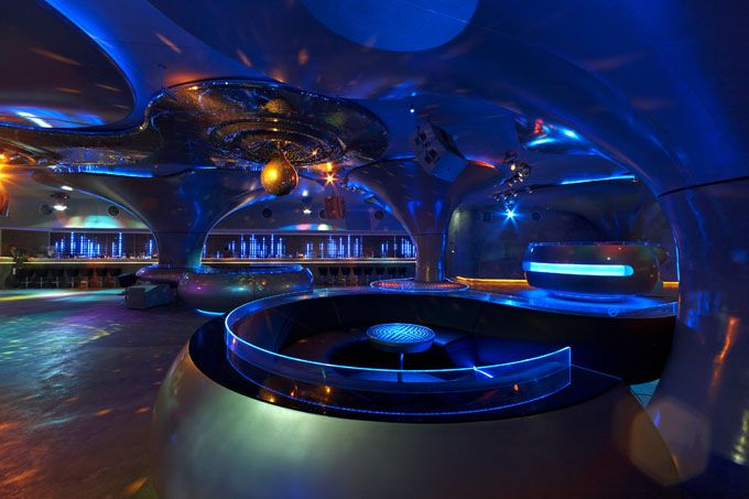 SOUND's design theme, realized by Orbit Design Studio (Bangkok, London and Tokyo) in association with Bed Supper Club, is the human ear in all of its super-human awesomeness, so everything in the interior is rounded, curved and tubular. While mimicking the human body, the SOUND environment with its intense audio and visual effects offers a surreal, out-of-body sci-fi experience.