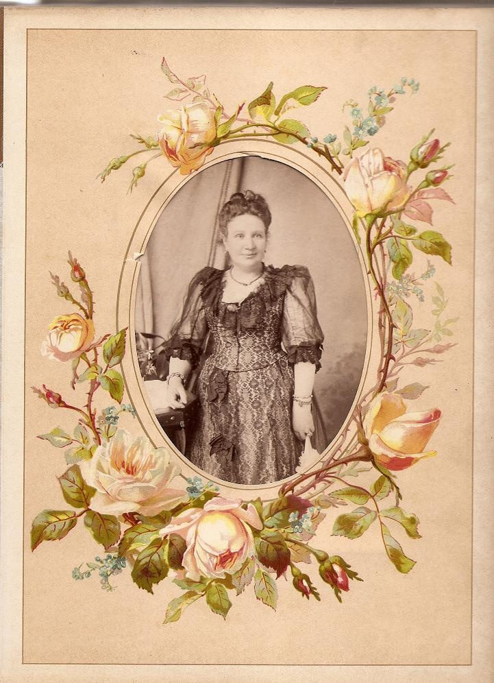 Sample page from the 1886 album. This page from the 1886 album displays a cabinet print dating to the late 1880s or early 1890s. The oval aperture has been elaborately framed with a painted floral border. This is characteristic of many late-Victorian albums. (Fiona Adams)