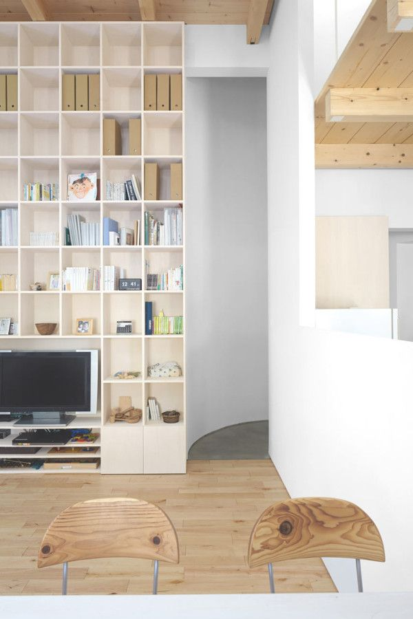 Floor-to-ceiling bookcases add plenty of storage space for the open interior.