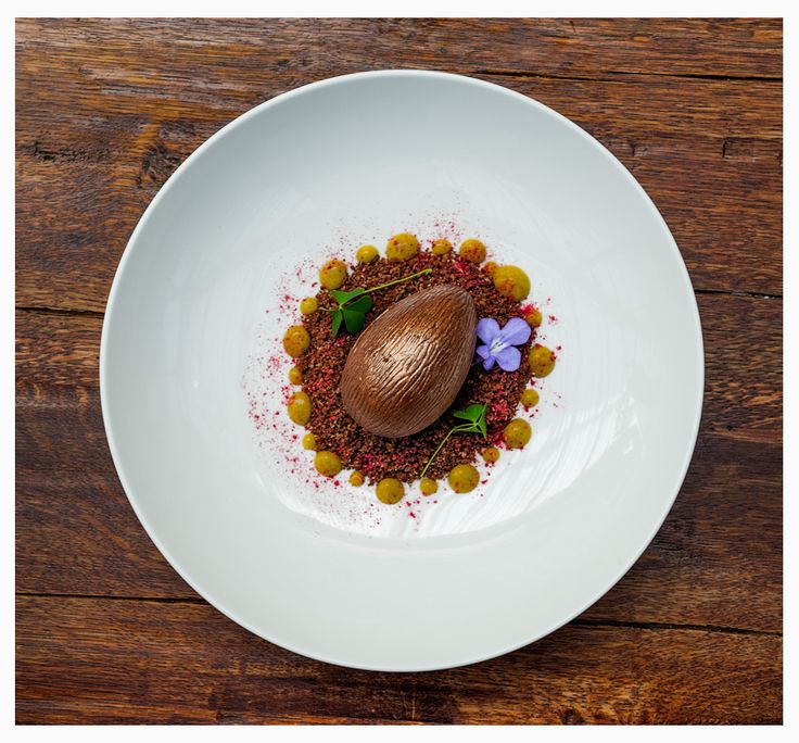 Chocolate egg with poppy seed ice cream, cereal crumble, asparagus jelly, sour cherry soup.