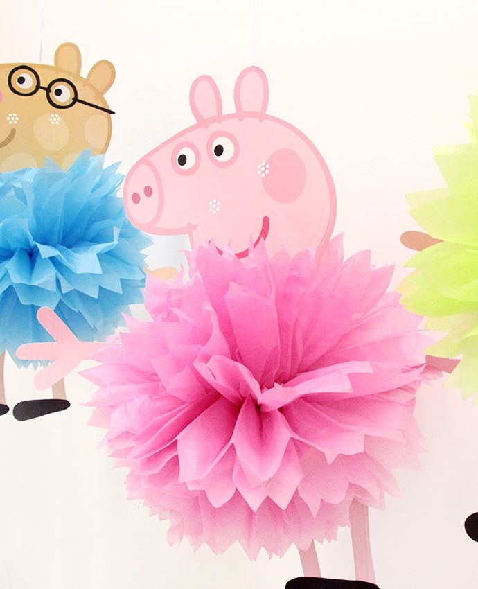 These Peppa Pig pom poms are so easy to make! All you need is brightly coloured paper pom poms, a selection of Peppa Pig masks and our free printable arms and legs. Such simple Peppa Pig party decorations that your guests will love!
